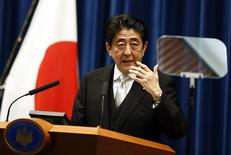 Japan's Prime Minister Shinzo Abe speaks during a news conference at his official residence in Tokyo December 24, 2014. REUTERS/Thomas Peter