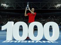Roger Federer of Switzerland poses with a giant number 1,000 after winning his thousandth career title in the men's singles final at the Brisbane International tennis tournament in Brisbane, January 11, 2015. REUTERS/Jason Reed