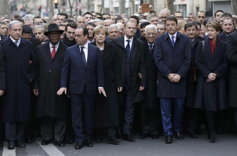French, foreign leaders walk arm-in-arm as millions...