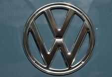 The Volkswagen logo is pictured  at the booth of German carmaker Volkswagen at the IAA truck show in Hanover, September 23,  2014.  REUTERS/Fabian Bimmer