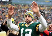 Jan 11, 2015; Green Bay, WI, USA; Green Bay Packers quarterback Aaron Rodgers (12) waves to the crowd after the 2014 NFC Divisional playoff football game against the Dallas Cowboys at Lambeau Field. Mandatory Credit: Andrew Weber-USA TODAY Sports