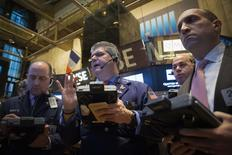 Traders work on the floor of the New York Stock Exchange January 8, 2015. REUTERS/Brendan McDermid