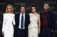 """(L-R) Cast members Nicola Peltz, Mark Wahlberg, Li Bingbing and Jack Reynor pose for pictures before the European premiere of the movie """"Transformers: Age of Extinction"""" in Berlin June 29, 2014. REUTERS/Thomas Peter"""