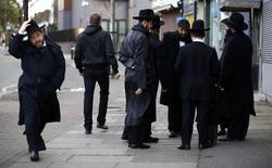 Jewish men talk in Golders Green, London, January 10, 2015. REUTERS/Paul Hackett