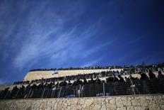 Mourners gather for the burial ceremony in Jerusalem for the victims of last Friday's attack on a Paris grocery, January 13, 2015.   REUTERS/Ammar Awad