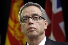 Canada's Finance Minister Joe Oliver listens to a question while speaking to journalists before the start of a meeting with his provincial and territorial counterparts in Ottawa December 15, 2014. REUTERS/Chris Wattie