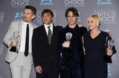 """(L-R) Actor Ethan Hawke with the Best Picture award, director Richard Linklater, actor Ellar Coltrane with the Best Young Actor/Actress award and actress Patricia Arquette with the Best Supporting Actress award for the film """"Boyhood"""" pose for photos during the 20th Annual Critics' Choice Movie Awards in Los Angeles, California January 15, 2015.  REUTERS/Kevork Djansezian"""