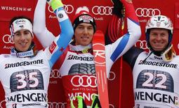 Winner Carlo Janka of Switzerland is flanked by second placed Victor Muffat-Jeandet of France (L) and Croatia's third placed Ivica Kostelic during the podium ceremony of the Alpine Skiing World Cup Super Combined in Wengen January 16, 2015.                       REUTERS/Ruben Sprich