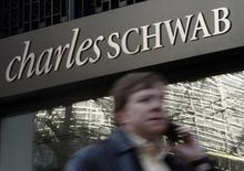 A man walks past a Charles Schwab Investment branch in Washington, in this file photo taken January 19, 2010.  REUTERS/Jim Young/Files