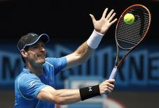 Britain's Andy Murray hits a shot during a practice session on Margaret Court Arena at Melbourne Park January 17, 2015. REUTERS/Athit Perawongmetha