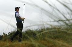 Jimmy Walker of the U.S. watches his tee shot on the 13th hole during the third round of the British Open Championship at the Royal Liverpool Golf Club in Hoylake, northern England July 19, 2014. REUTERS/Stefan Wermuth/Files
