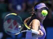 Ana Ivanovic of Serbia hits a return to Lucie Hradecka of Czech Republic during their women's singles first round match at the Australian Open 2015 tennis tournament in Melbourne January 19, 2015. Ivanovic lost the match to Hradecka.   REUTERS/Issei Kato