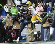 January 18, 2015; Seattle, WA, USA; Seattle Seahawks cornerback Richard Sherman (25) intercepts a pass intended for Green Bay Packers wide receiver Davante Adams (17) during the first half in the NFC Championship game at CenturyLink Field.  Kyle Terada-USA TODAY Sports