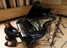 Award-winning Hungarian pianist Gergely Boganyi plays his new concept piano at a recording studio in Budapest January 13, 2015.  REUTERS/Laszlo Balogh