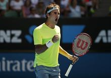 Roger Federer of Switzerland celebrates winning a point over Simone Bolelli of Italy during their men's singles second round match at the Australian Open 2015 tennis tournament in Melbourne January 21, 2015. REUTERS/Thomas Peter