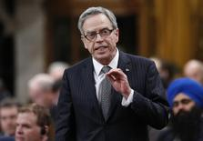 Canada's Finance Minister Joe Oliver speaks during Question Period in the House of Commons on Parliament Hill in Ottawa November 20, 2014. REUTERS/Chris Wattie