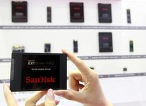 Sandisk's new solid state drive is displayed at the Sandisk booth during the 2014. REUTERS/Pichi Chuang