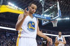 January 14, 2015; Oakland, CA, USA; Golden State Warriors guard Stephen Curry (30) celebrates after a basket against the Miami Heat during the third quarter at Oracle Arena. The Warriors defeated the Heat 104-89. Kyle Terada-USA TODAY Sports