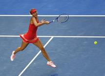 Maria Sharapova of Russia hits a return against Zarina Diyas of Kazakhstan during their women's singles third round match at the Australian Open 2015 tennis tournament in Melbourne January 23, 2015. REUTERS/Carlos Barria