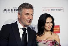 "Actor Alec Baldwin (L) and his wife Hilaria Baldwin arrive at the Elton John AIDS Foundation's 12th Annual ""An Enduring Vision"" benefit gala at Cipriani in New York October 15, 2013. REUTERS/Eduardo Munoz"