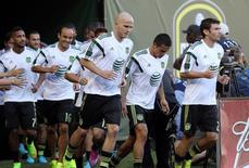 Aug 6, 2014; Portland, OR, USA; MLS All Stars midfielder Michael Bradley (middle) of Toronto FC runs onto the field with his teammates before the 2014 MLS All Star Game at Providence Park. Mandatory Credit: Jaime Valdez-USA TODAY Sports - RTR41I2S