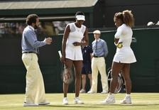 Serena (R) and VenusWilliams  at the Wimbledon Tennis Championships, in London July 1, 2014.           REUTERS/Toby Melville