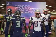 Jan 23, 2015; Glendale, AZ, USA; General view of mannequins with the uniform and helmets of Seattle Seahawks cornerback Richard Sherman (25) and quarterback Russell Wilson (3) and New England Patriots tight end Rob Gronkowski (87) and cornerback Darrelle Revis (24) at the Nike Factory Store at the Tanger Outlets in advance of Super Bowl XLIX between the Seattle Seahawks and the New England Patriots. Mandatory Credit: Kirby Lee-USA TODAY Sports