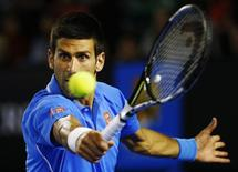 Novak Djokovic of Serbia hits a return to Gilles Muller of Luxembourg during their men's singles fourth round match at the Australian Open 2015 tennis tournament in Melbourne January 26, 2015. REUTERS/Issei Kato