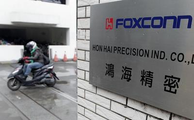 Exclusive: Apple supplier Foxconn to shrink workforce as sales growth stalls