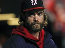 Washington Nationals right fielder Jayson Werth watches the game from the dugout during the ninth inning of their MLB National League baseball game against the St. Louis Cardinals in St. Louis, Missouri, September 28, 2012. REUTERS/Sarah Conard