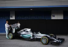 Mercedes Formula One racing driver Lewis Hamilton (R) of Britain and teammate Nico Rosberg of Germany unveil the new Mercedes F1 M06 car during its official presentation at the Jerez racetrack in southern Spain February 1, 2015.  REUTERS/Marcelo del Pozo