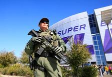 Feb 1, 2015; Glendale, AZ, USA; Police officers patrol outside the stadium prior to the game between the New England Patriots and the Seattle Seahawks in Super Bowl XLIX at University of Phoenix Stadium. Andrew Weber-USA TODAY Sports