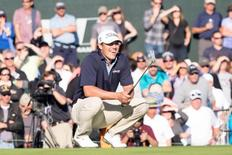 Feb 1, 2015; Scottsdale, AZ, USA; Brooks Koepka reacts after missing his putt on the 18th hole during the final round of the Waste Management Phoenix Open at TPC Scottsdale. Allan Henry-USA TODAY Sports