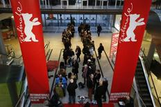 People queue to buy tickets for the upcoming 65th Berlinale International Film Festival, in Berlin February 2, 2015. REUTERS/Fabrizio Bensch