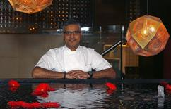Chef Atul Kochhar, the first Indian chef to receive a Michelin star, poses at his Benares restaurant in Mayfair, central London January 21, 2015. REUTERS/Eddie Keogh