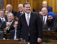 Canada's Foreign Minister John Baird reacts while announcing his resignation in the House of Commons on Parliament Hill in Ottawa February 3, 2015. REUTERS/Chris Wattie