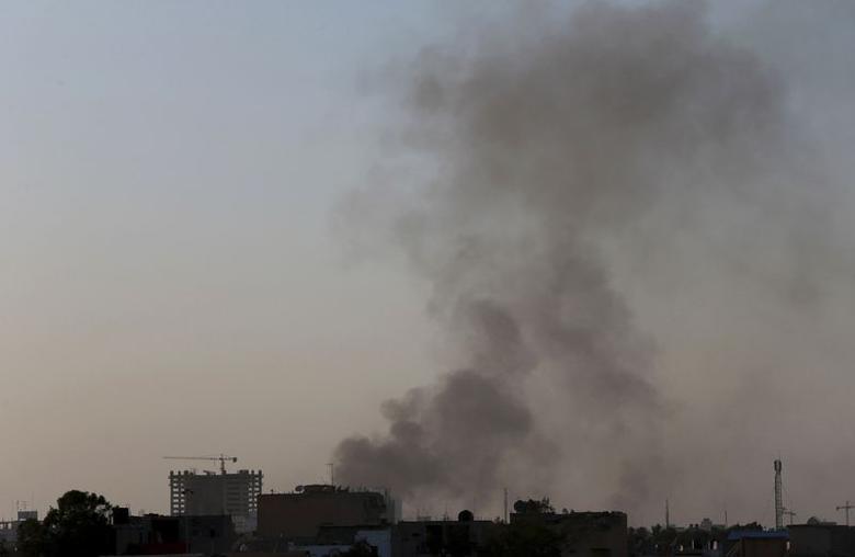 Black smoke raises into the air near Benghazi port, where there are violent clashes, in Benghazi February 7, 2015. REUTERS/Esam Omran Al-Fetori
