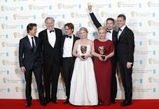 """Presenter Tom Cruise (L) celebrates with (2nd L-R) Jonathan Sehring, Ellar Coltrane, Cathleen Sutherland, Patricia Arquette Ethan Hawke, and John Sloss after they won the best film award for """"Boyhood"""" at the British Academy of Film and Arts (BAFTA) awards ceremony at the Royal Opera House in London February 8, 2015. REUTERS/Suzanne Plunkett"""