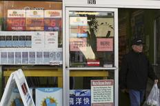 A man leaves a store selling Powerball tickets in San Francisco, California February 10, 2015.   REUTERS/Robert Galbraith