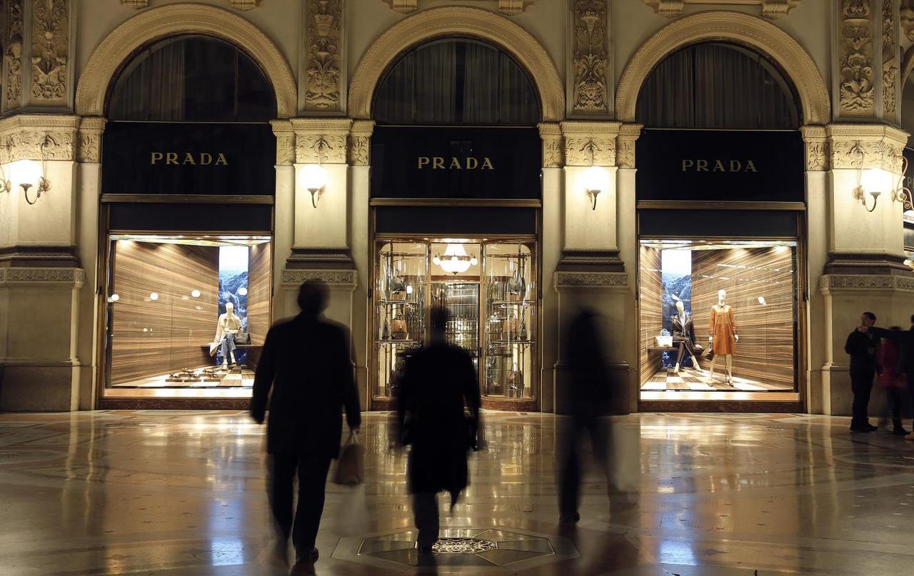 774959e9e9d People walk past Prada's fashion store in downtown Milan February 4, 2015.  REUTERS/Stefano Rellandini