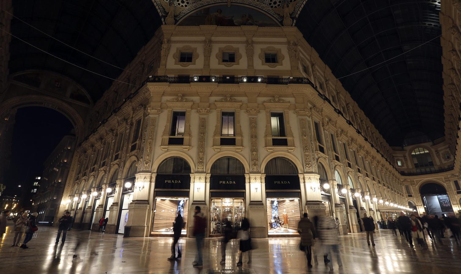 "47316cf7eec People walk past Prada's fashion store in downtown Milan February 4, 2015.  REUTERS/Stefano Rellandini. """