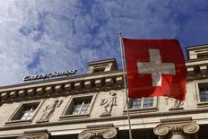 A national flag of Switzerland flies in front of a branch office of Swiss bank Credit Suisse in Luzern October 30, 2014.  REUTERS/Arnd Wiegmann