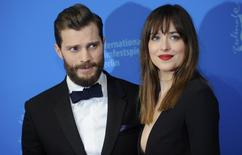Actors Dakota Johnson and Jamie Dornan (L)  arrive for the screening of the movie 'Fifty Shades of Grey' at the 65th Berlinale International Film Festival in Berlin February 11, 2015.    REUTERS/Stefanie Loos