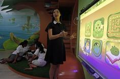 Dreamkids Kindergarten principal Dawn Choy shows how the Smart Board is used for educational games in class as teachers plan their lessons in an Angry Birds-inspired classroom environment in Singapore February 11, 2015. REUTERS/Edgar Su