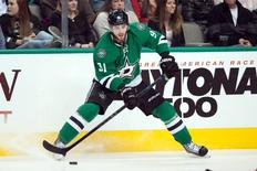 Feb 13, 2015; Dallas, TX, USA; Dallas Stars center Tyler Seguin (91) skates against the Florida Panthers during the third period at the American Airlines Center. Seguin leaves the game with an injury. The Stars shut out the Panthers 2-0. Mandatory Credit: Jerome Miron-USA TODAY Sports