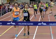 Matt Centrowitz (USA), right, defeats Nick Willis (NZL) to win the Wanamaker Mile, 3:51.35 to 3:51.46, in the 108th Millrose Games at Armory. Mandatory Credit: Kirby Lee-USA TODAY Sports