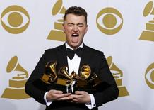 "Sam Smith poses with his awards for Best New Artist, Best Pop/Vocal Album for ""In the Lonely Hour"" and Song of the Year and Record of the Year for ""Stay With Me"" in the press room at the 57th annual Grammy Awards in Los Angeles, California February 8, 2015.   REUTERS/Mike Blake"