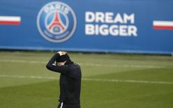 Paris St Germain (PSG) player Zlatan Ibrahimovic attends a training session ahead of their Champions League soccer match against Chelsea, at the Camp des Loges training center in Saint-Germain-en-Laye, near Paris, February 16, 2015.    REUTERS/Christian Hartmann