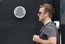 A man walks past Snapchat's headquarters in Venice, Los Angeles California October 13, 2014. REUTERS/Lucy Nicholson