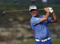 Darren Clarke of Northern Ireland tees off on the 15th tee during the third day of practice for the 96th PGA Championship at Valhalla Golf Club in Louisville, Kentucky, August 6, 2014. REUTERS/ John Sommers II